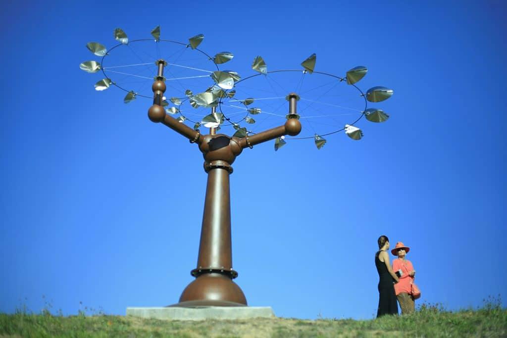 A sculpture set against a blue sky